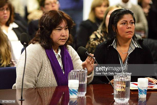 Maria Gonzalez speaks as family spokesperson Awilda Cordero looks on during the first of several State Assembly hearings at 250 Broadway looking into...