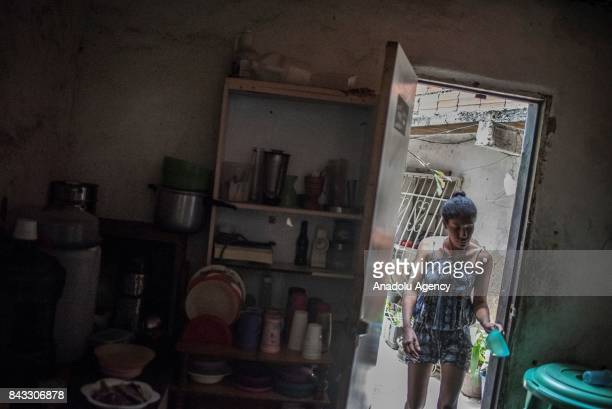 Maria Gonzalez walks into her house in the Sector Antonio Jose de Sucre part of the Petare Slum the biggest favela of Venezuela with more than 1...