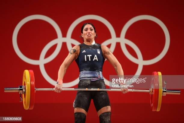 Maria Grazia Alemanno of Team Italy competes during the Weightlifting - Women's 59kg Group B on day four of the Tokyo 2020 Olympic Games at Tokyo...