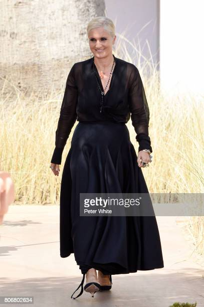Maria Grazia Chiuri acknowledges the audience after the Christian Dior Haute Couture Fall/Winter 20172018 show as part of Haute Couture Paris Fashion...