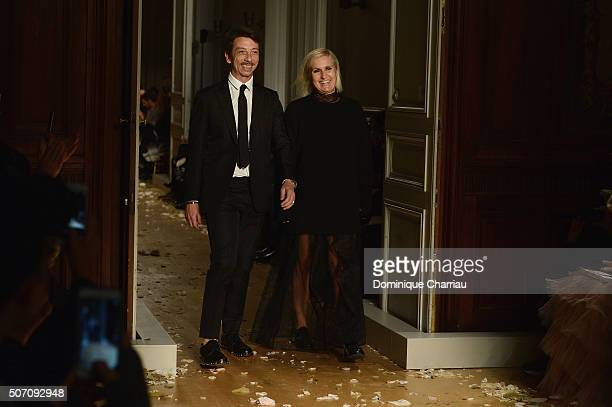 Maria Grazia Chiuri and Pier Paolo Picciolis pose on the runway during the Valentino Haute Couture Spring Summer 2016 show as part of Paris Fashion...