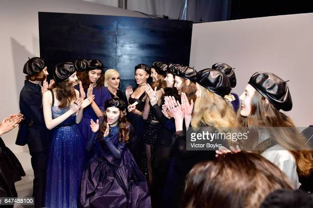 Maria Grazia Chiuri is greeted by models backstage after the Christian Dior show as part of the Paris Fashion Week Womenswear Fall/Winter 2017/2018...