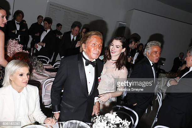 Maria Grazia Chiuri Valentino Garavani Anne Hathaway Giancarlo Giammetti and Sidney Toledano attend the Guggenheim International Gala at the Solomon...