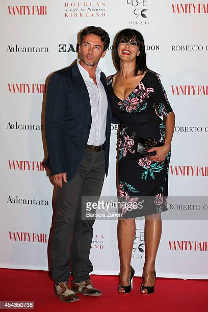 Maria Grazia Cucinotta and Alessio BOni attends the opening of ' Douglas Kirkland a Life in Pictures' Exhibition at Telecom Future Center on August...