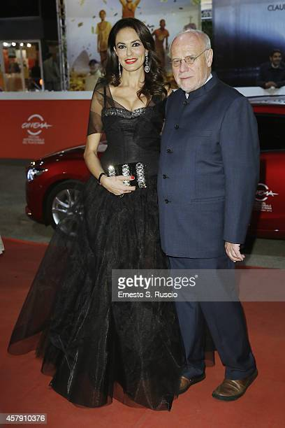 Maria Grazia Cucinotta and Marco Muller attend the 'Il Postino' red carpet during the 9th Rome Film Festival on October 26 2014 in Rome Italy