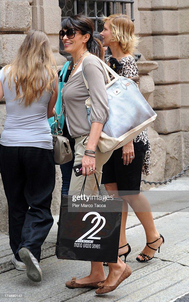 Maria Grazia Cucinotta and Maria Grazia Severi are sighted in via Montenapoleone on July 29, 2013 in Milan, Italy.