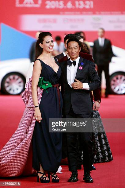 Maria Grazia Cucinotta and Simon Yam poses for a picture on the red carpet at The 18th Shanghai International Film Festival on June 13 2015 in...