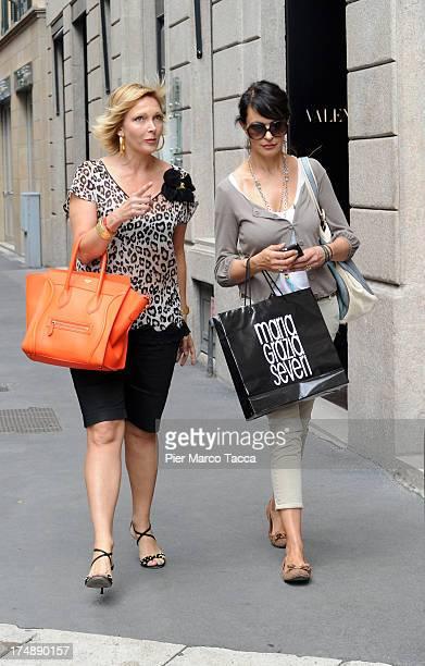Maria Grazia Severi and Maria Grazia Cucinotta are sightinged in via Montenapoleone on July 29, 2013 in Milan, Italy.