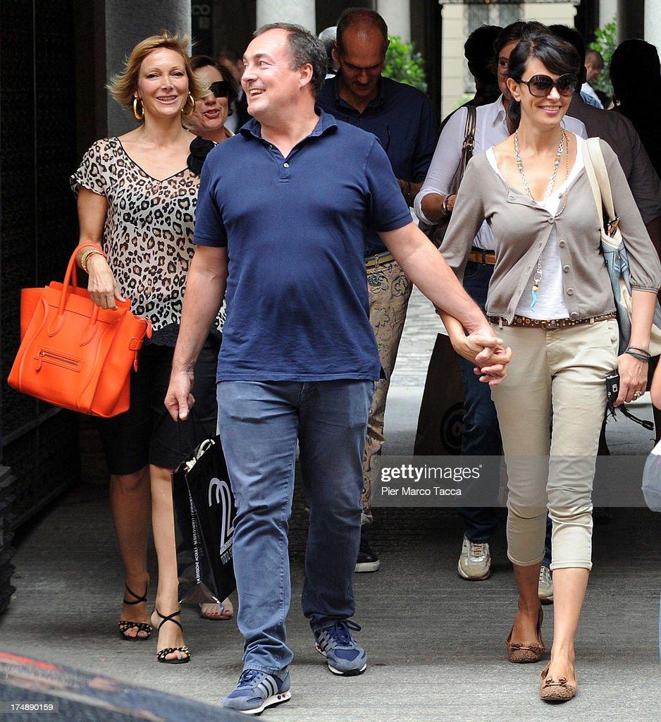 Maria Grazia Severi, Giulio Violati and Maria Grazia Cucinotta are sighted in via Montenapoleone on July 29, 2013 in Milan, Italy.