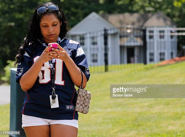 Maria Grullon of Worcester drove to North Attleborough to see New England Patriots player Aaron Hernandez's home She wears his jersey as she stands...
