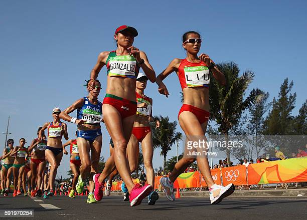 Maria Guadalupe Gonzalez of Mexico and Hong Liu of China lead the group as they compete in the Women's 20km Walk final on Day 14 of the Rio 2016...