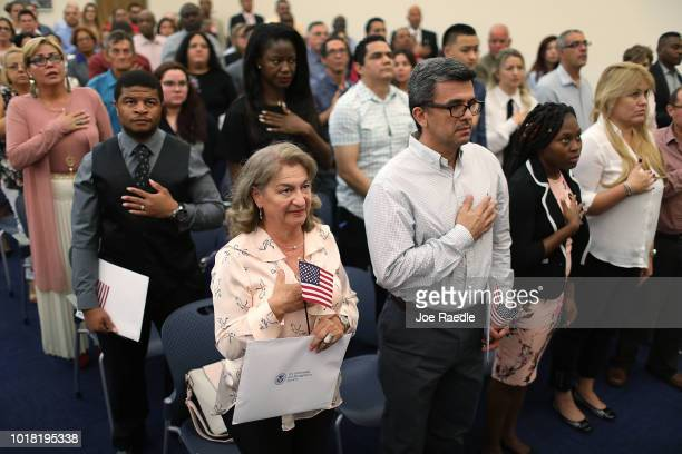 Maria Gutierrez orginally from Columbia and Henry Garcia orginally from Nicaragua participates in a ceremony to become an American citizen during a...