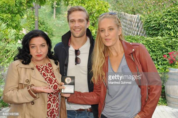 Maria Happel Michael Steinocher and Lilian Klebow pose during a 'Soko Wien' photo call at Heuriger TratWieser on August 28 2017 in Klosterneuburg...