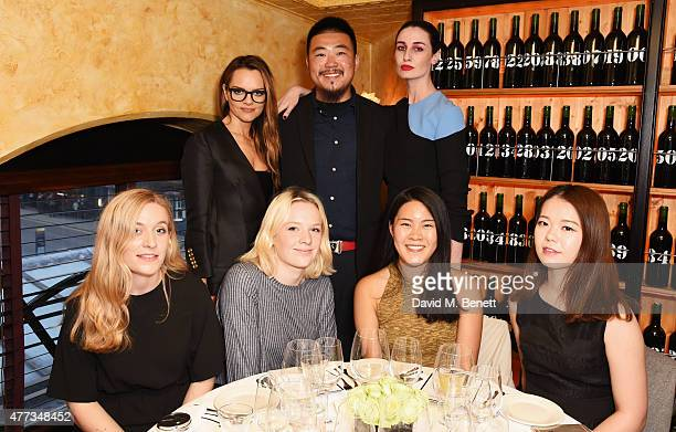 Maria Hatzistefanis and Erin O'Connor pose with Central Saint Martins students at a dinner hosted by Maria Hatzistefanis to launch the Rodial Design...
