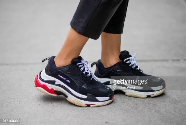 Maria Hatzistefanis wearing black Marissa Webb pants Off White belt Awake knit black Balenciaga sneakers white Balenciaga bag Moncler sunglasses seen...