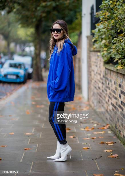 Maria Hatzistefanis wearing blue Vetements jumper hoddy with European Union print striped Etre Cecile pants white Balenciaga shoes Celine sunglasses...