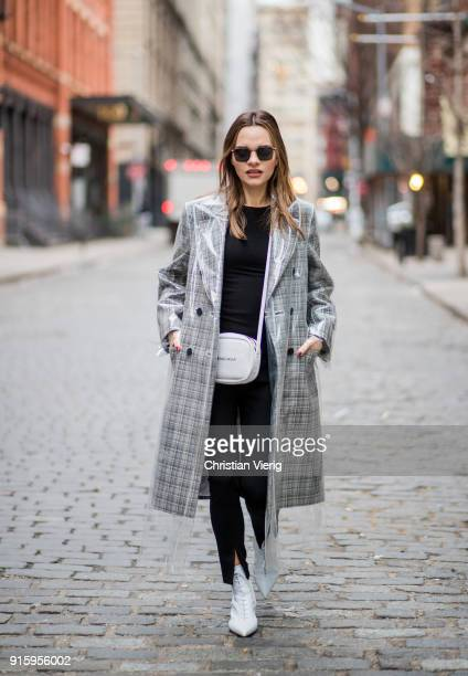 Maria Hatzistefanis wearing Calvin Klein coat Balenciaga bag Tabitha Simmons white boots seen on February 8 2018 in New York City
