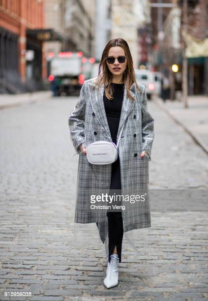 Maria Hatzistefanis wearing Calvin Klein coat Balenciaga bag Tabitha Simmons white boots seen on February 8 2018 in New York City