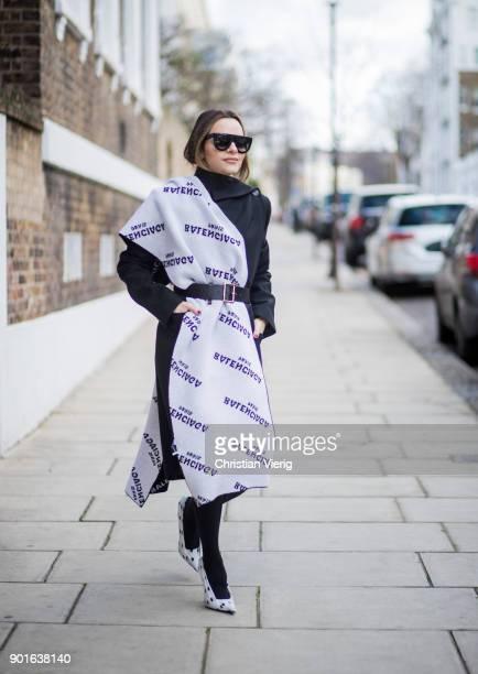 Maria Hatzistefanis wearing Celine sunglasses Balenciaga coat Balenciaga blanket Frame belt Balenciaga heels during London Fashion Week Men's January...