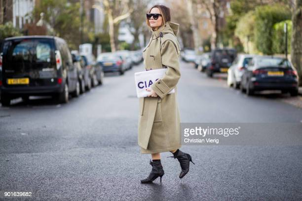 Maria Hatzistefanis wearing oversized olive wool coat Balenciaga Balenciaga clutch Celine shoes Celine sunglasses belt Frame during London Fashion...