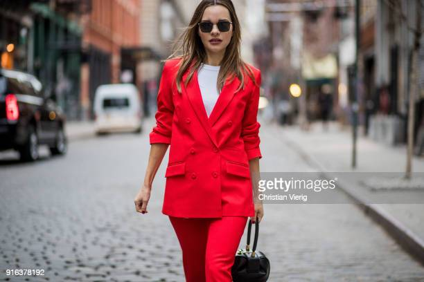 Maria Hatzistefanis wearing red blazer jacket red Roland Mouret trousers Balenciaga sneakers Gabriela Hearst bag seen on February 9 2018 in New York...