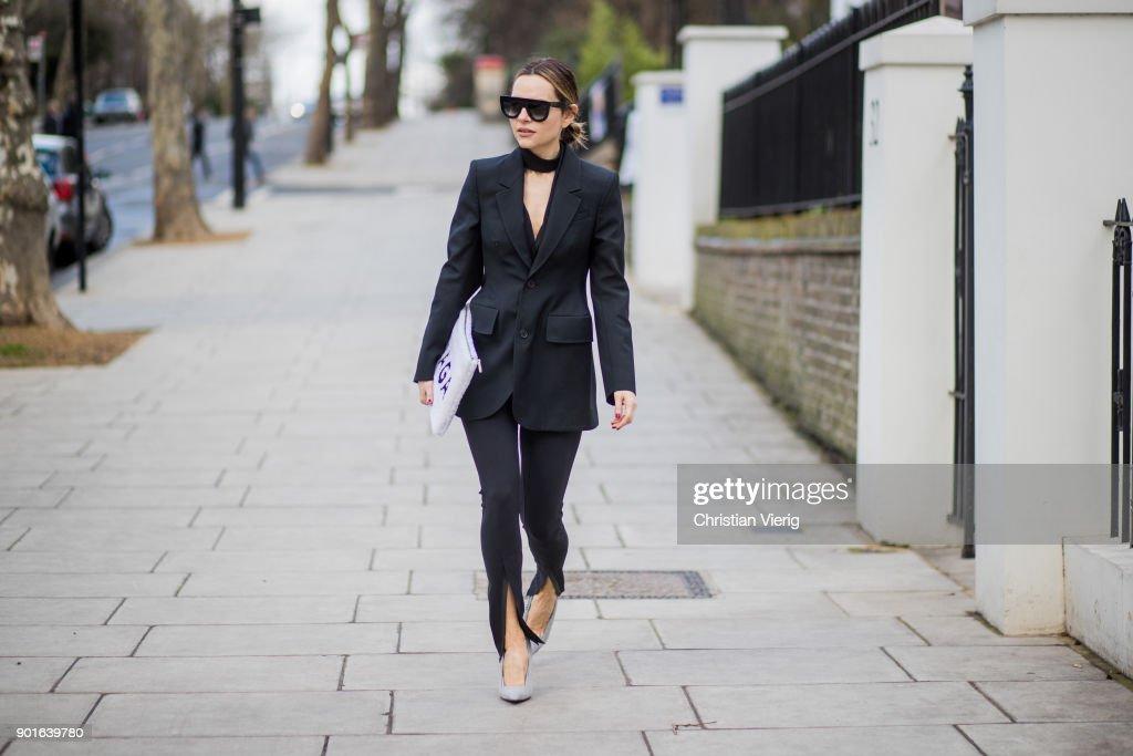 Maria Hatzistefanis wearing WARDROBE.NYC pants, Balenciaga clutch, Balenciaga blazer, Celine sunglasses, heels during London Fashion Week Men's January 2018 on January 5, 2018 in London, England.