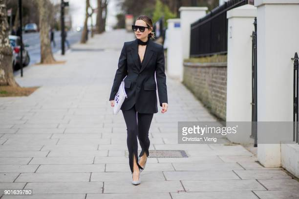 Maria Hatzistefanis wearing WARDROBENYC pants Balenciaga clutch Balenciaga blazer Celine sunglasses heels during London Fashion Week Men's January...