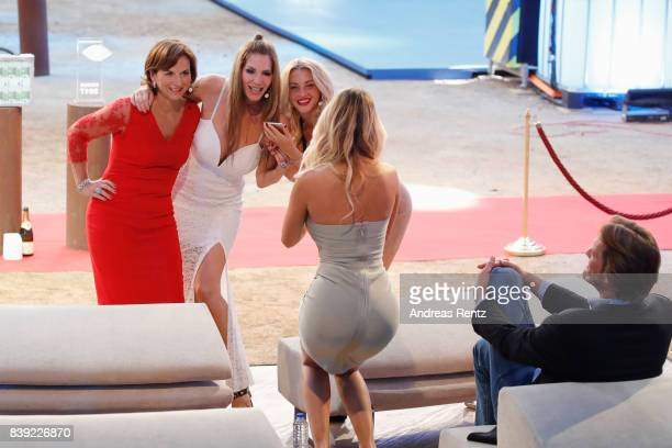 Maria Hering takes a photograph of Claudia Obert Sarah Kern and Evelyn Burdecki attend the finals of 'Promi Big Brother 2017' at MMC Studio on August...
