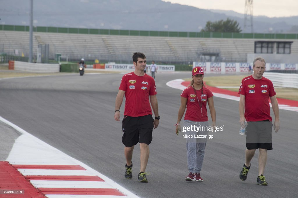 Maria Herrera of Spain and AGR Team checks the track with mechanics during the MotoGP of San Marino - Previews at Misano World Circuit on September 7, 2017 in Misano Adriatico, Italy.