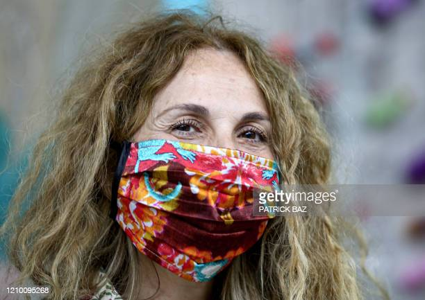 Maria Hibri a Lebanese fashion designer and a cofounder of a local fashion studio poses while wearing a face mask of her creation made from organic...