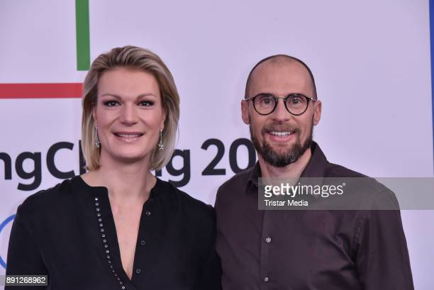 Maria HoeflRiesch and Marco Buechel during the Olympia Press Conference on December 12 2017 in Berlin Germany