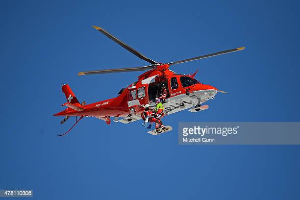 Maria HoeflRiesch of Germany being transported by the air ambulance after crashing during the Audi FIS Alpine Skiing World Cup Finals downhill on...