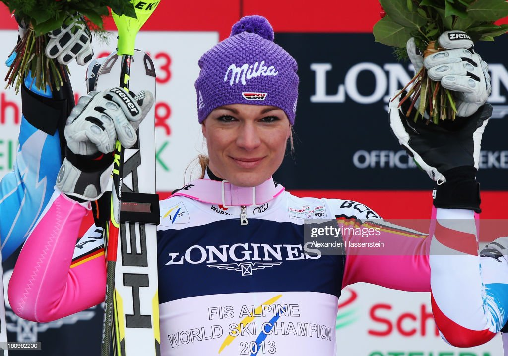 Maria Hoefl-Riesch of Germany celebrates at the flower ceremony after winning the Women's Super Combined during the Alpine FIS Ski World Championships on February 8, 2013 in Schladming, Austria.