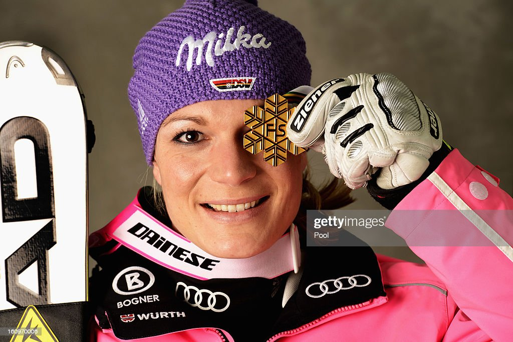 Maria Hoefl-Riesch of Germany celebrates with her gold medal after winning the Women's Super Combined during the Alpine FIS Ski World Championships on February 8, 2013 in Schladming, Austria.