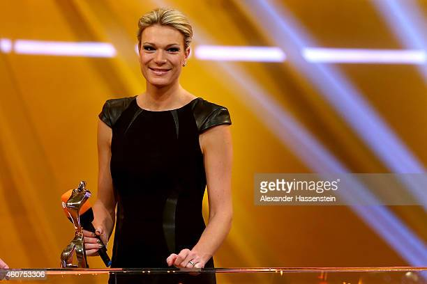 Maria Hoefl-Riesch smiles with the Athlete of the Year award during the Sportler des Jahres 2014 gala at the Kurhaus Baden-Baden on December 21, 2014...