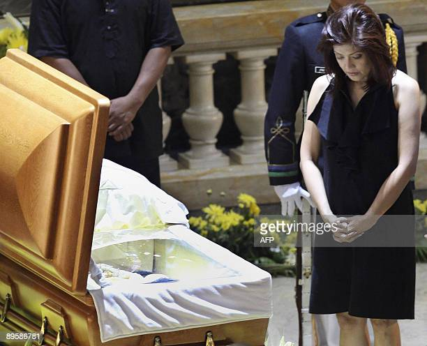 Maria Imelda Josefa Imee Marcos daughter of the late strongman Ferdinand Marcos views the casket of the late former Philippines president Corazon...