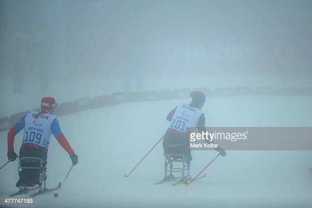 Maria Iovela of Russia and Oksana Master of the USA compete in the Women's 10km Sitting during day four of Sochi 2014 Paralympic Winter Games at...