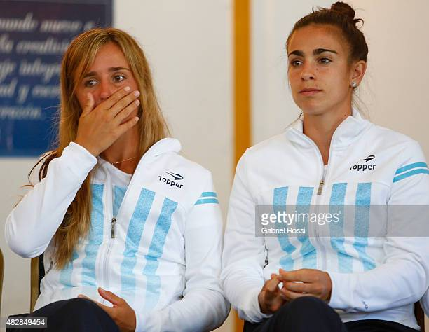Maria Irigoyen and Paula Ormaechea of Argenitna look on during the draw ceremony prior to a match between Argentina and USA as part of Fed Cup 2015...