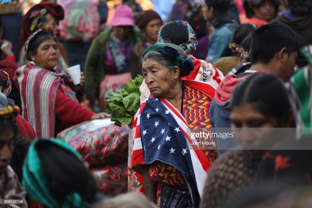 Maria Isabel Luna, 75, wears an American towel for warmth over her traditional Mayan dress while working at a vegetable market on February 11, 2017 in Almolonga, Guatemala. She said that two of her family members work as immigrant laborers in Los Angeles. The Mayan town in the western highlands district of Quetzaltenango has surged in prosperity in recent years with high-productivity vegetable farming, exporting much of its excess crops to neighborning El Salvador. The town has been called the 'Vegetable Basket of the Americas.' Many locals attribute the town's change in fortunes to the rapid growth of the Evangelical Christian faith in the area, while others credit the increased use of pesticide farming. Regardless, the strong local economy will be key maintaining the town's prosperity if the Trump Administration follows through on curtailing remittance money sent back from undocumented immigrants in the U.S. to their families in Guatemala.