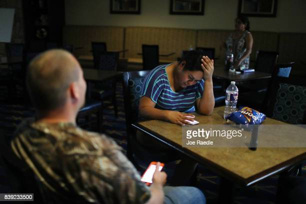 Maria Jaramillo and other guests of the TownPlace Suites hotel wait out Hurricane Harvey on August 25 2017 in Corpus Christi Texas Hurricane Harvey...
