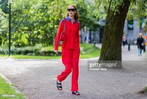 Maria Jernov wearing a red suit and Birkenstock sandals and red Chanel bag outside Daisy Grace during the third day of the Stockholm Fashion Week...