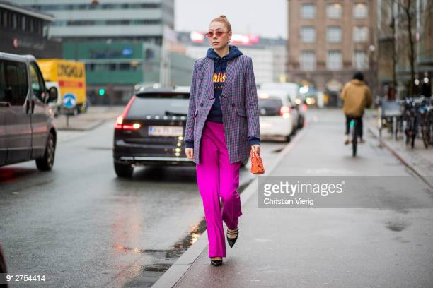 Maria Jernov wearing hoodie pink pants checked blazer outside Anne Vest during the Copenhagen Fashion Week Autumn/Winter 18 on January 31 2018 in...