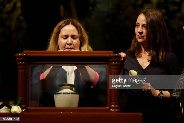 Maria Jose and Mariana daughters of Jose Luis Cuevas stand guard during an homage to Mexican artist Jose Luis Cuevas at Bellas Artes Palace on July...