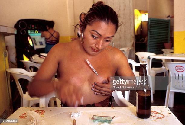 Maria Jose injects hormones into her breast to enlarge them She says that she would like to do it twice a week but doesn't have the money needed Each...