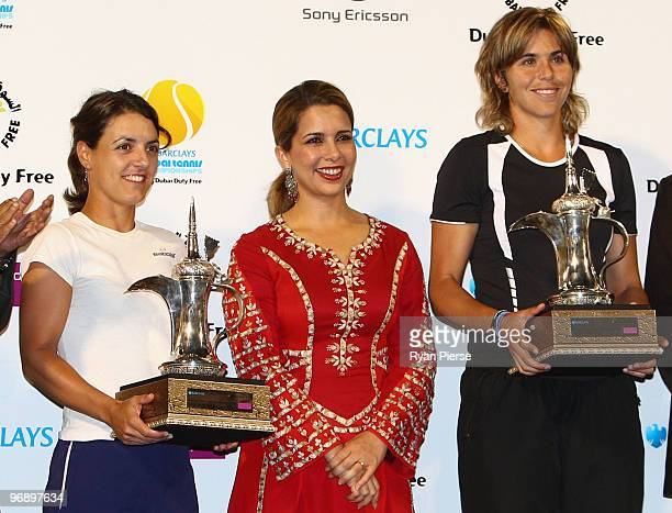 Maria Jose Martinez Sanchez of Spain and Nuria Llagostera Vives of Spain accept their winners trophies from Jordan's Princess Haya bint alHussein...