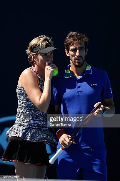 Maria Jose Martinez Sanchez of Spain and Pablo Cuevas of Uruguay compete in their first round match against Katerina Siniakova of the Czech Republic...