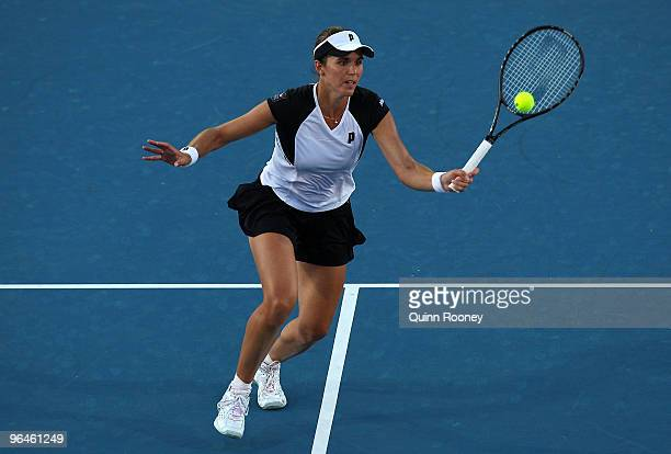 Maria Jose Martinez Sanchez of Spain plays a forehand volley in her singles match against Sam Stosur of Australia during the 2010 Fed Cup World Group...