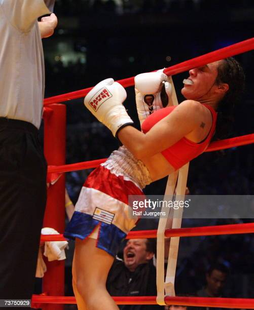 Maria Jose Nunez Anchorena of Uruguay is hit during the flyweight WBA World Championship fight against Susianna Kentikian of Germany at the Cologne...