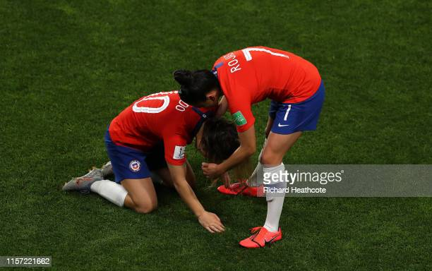 Maria Jose Rojas of Chile consoles teammate Yanara Aedo of Chile following the 2019 FIFA Women's World Cup France group F match between Thailand and...