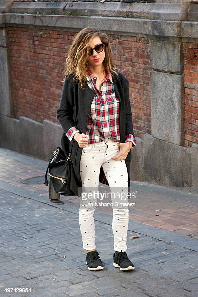 Maria Jose wears Lefties sneakers Maison Scotch trousers Zadig and Voltaire shirt and coat and Pull and Bear handbag at Malasaa neighborhood on...